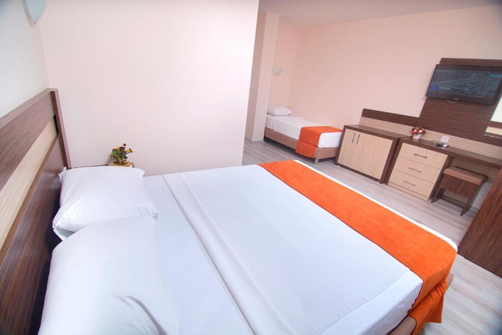 Кровать или кровати в номере Enki Hotel
