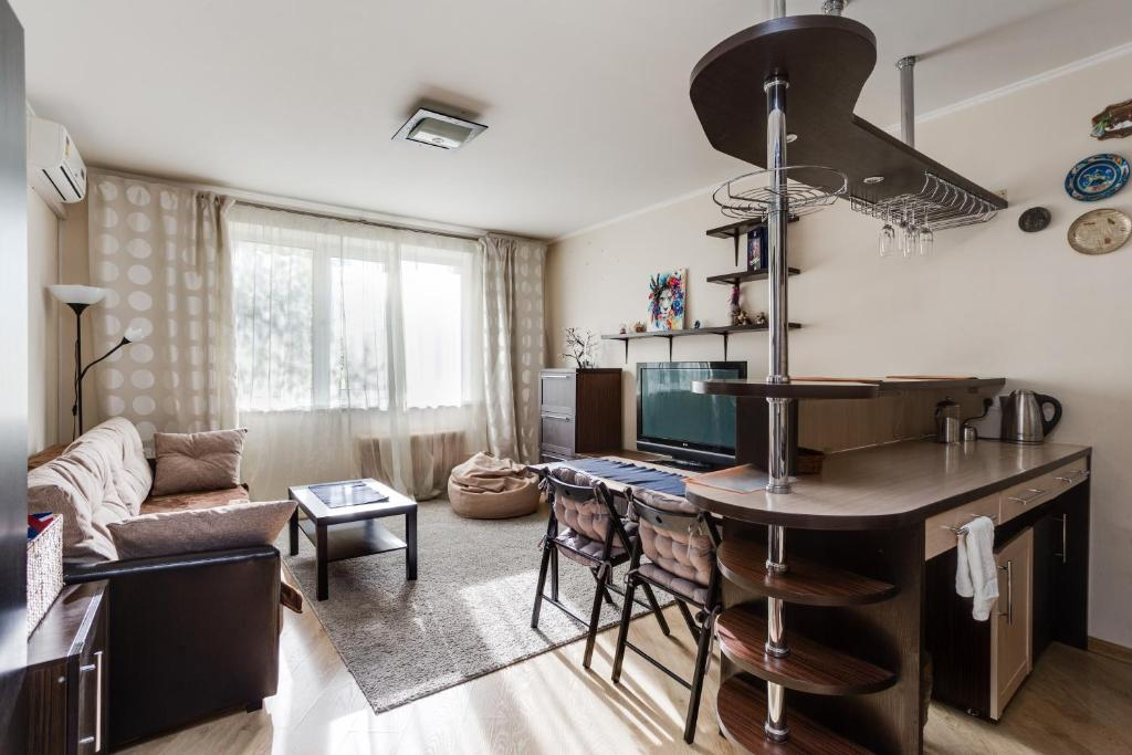A television and/or entertainment centre at Home Like on Govorova 32