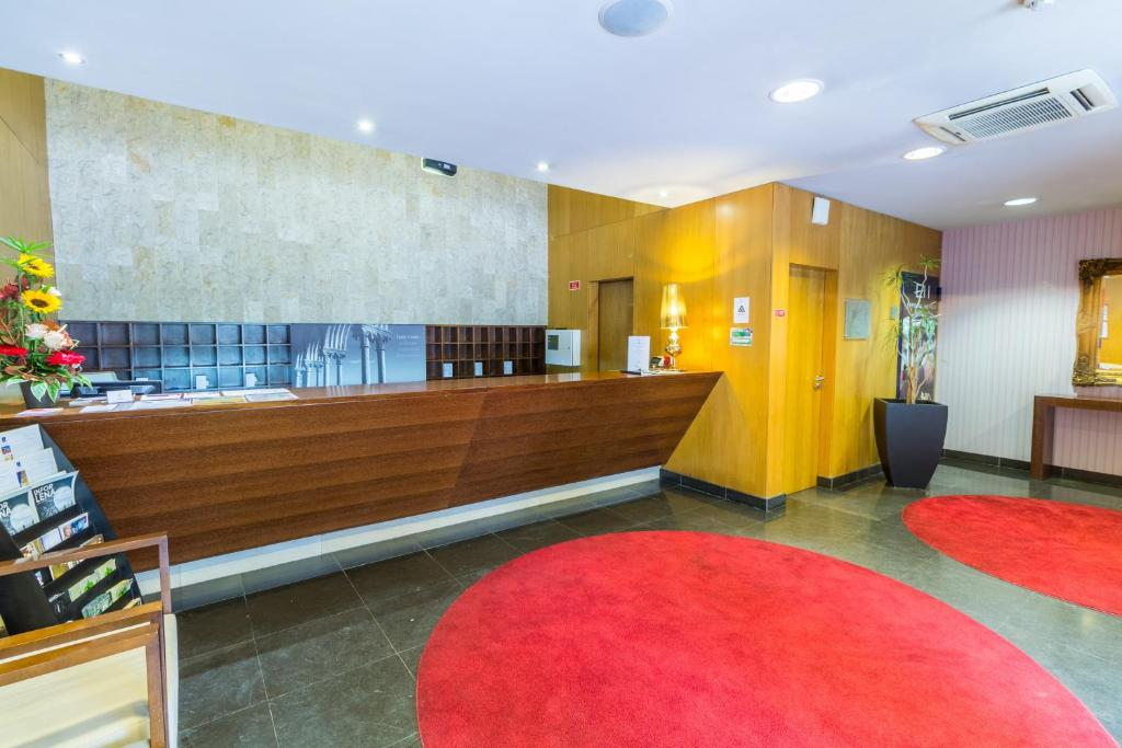 The lobby or reception area at Eurosol Residence
