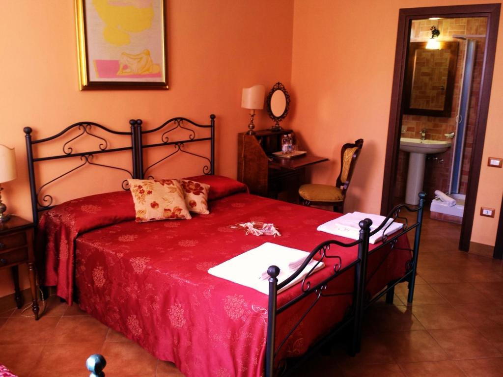 Ein Bett oder Betten in einem Zimmer der Unterkunft B&B De Nuce Maga