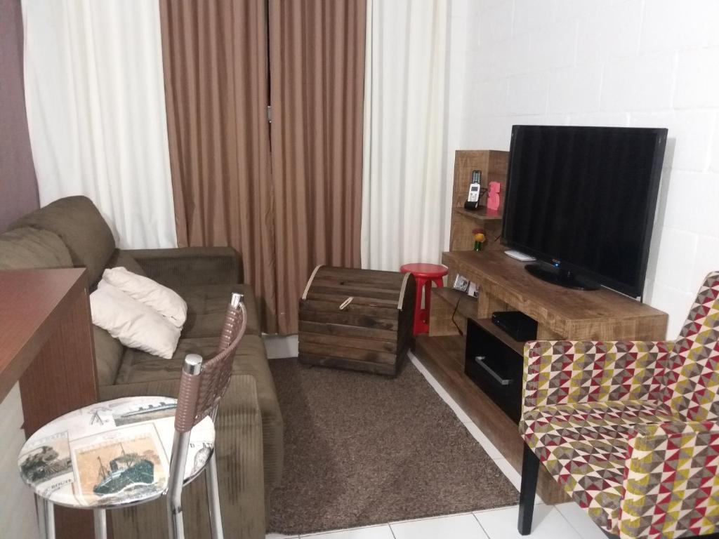 A seating area at Apartamento Temporada Canela