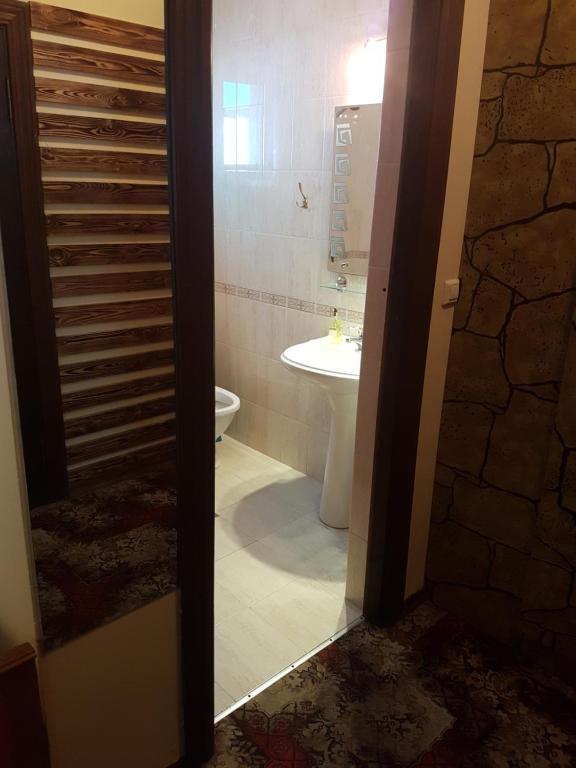Ванная комната в Guest house Atlantik