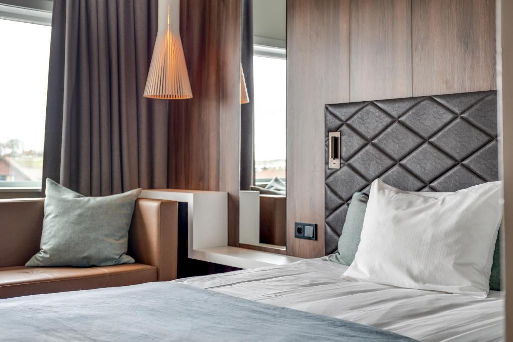 En eller flere senger på et rom på Quality Airport Hotel Stavanger