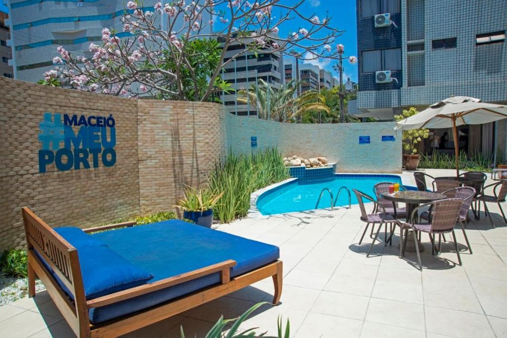 The swimming pool at or near Hotel Porto da Praia