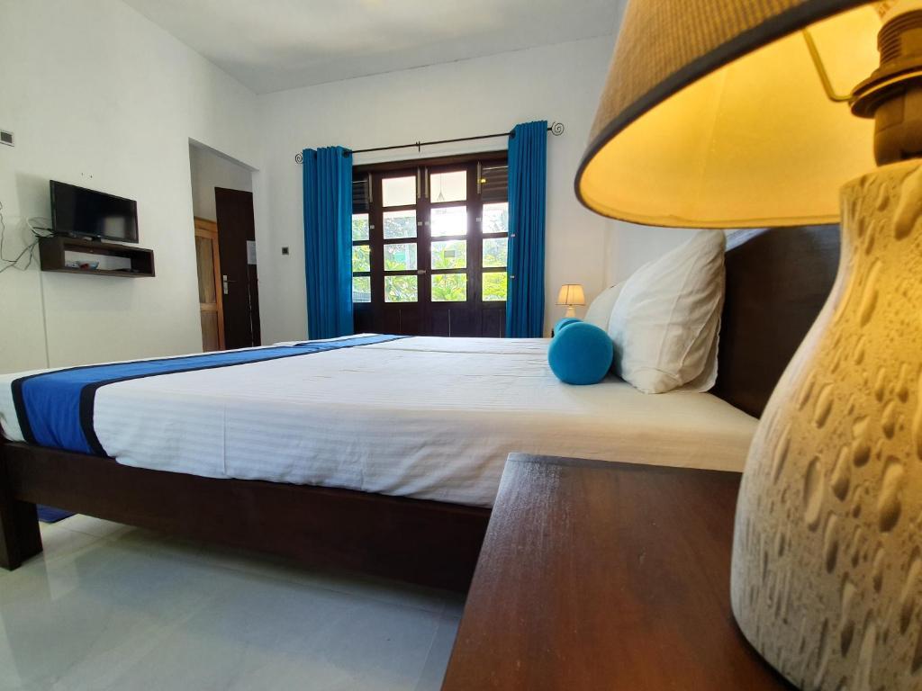 A bed or beds in a room at Coastal Villa Mirissa