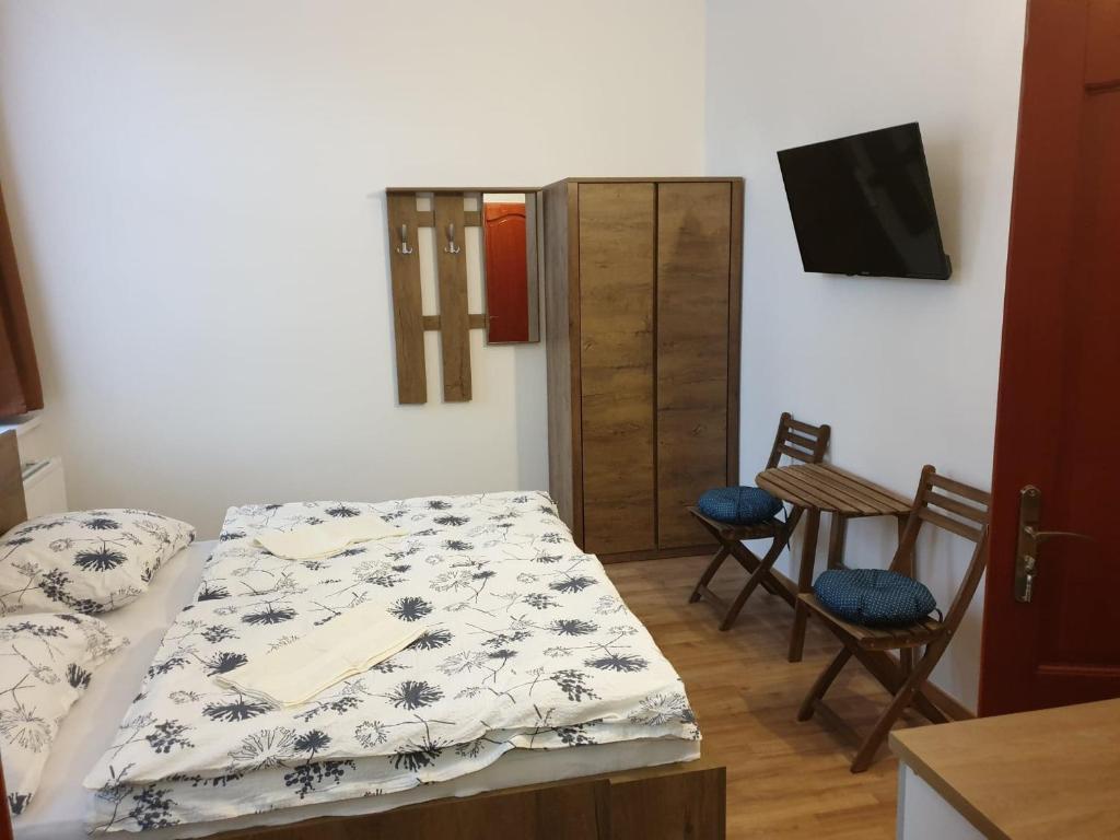 Ein Bett oder Betten in einem Zimmer der Unterkunft Guest House Orczy Park