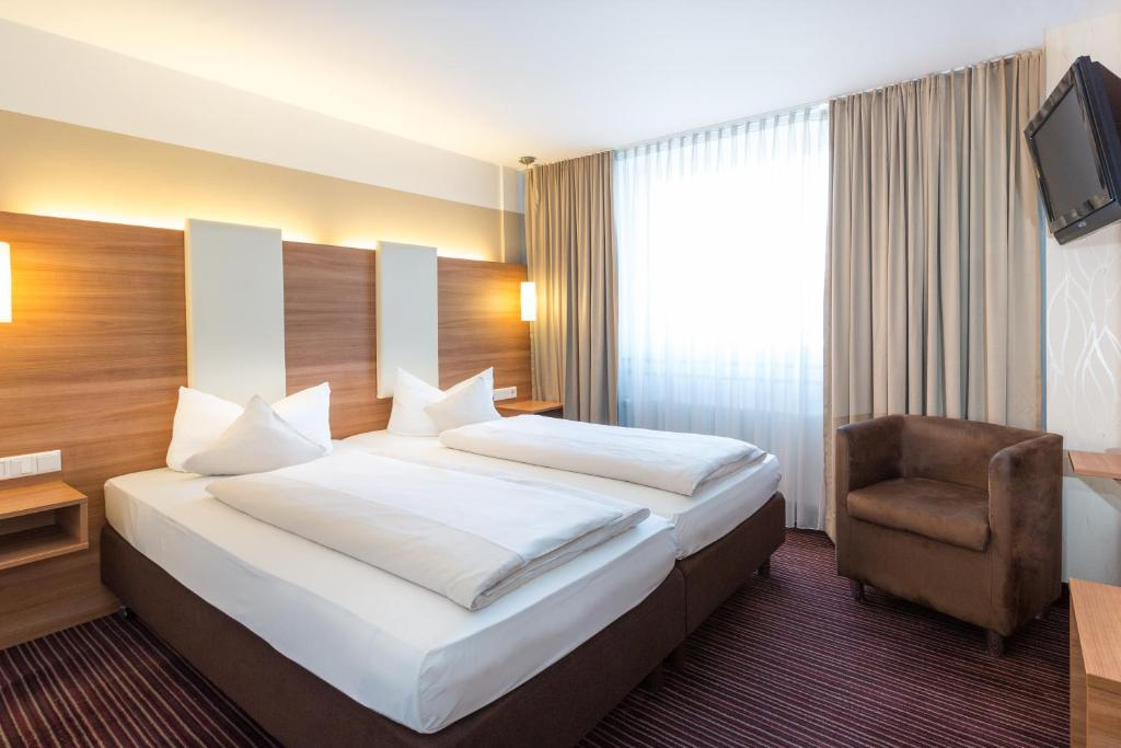 Ein Bett oder Betten in einem Zimmer der Unterkunft Hotel Cristal