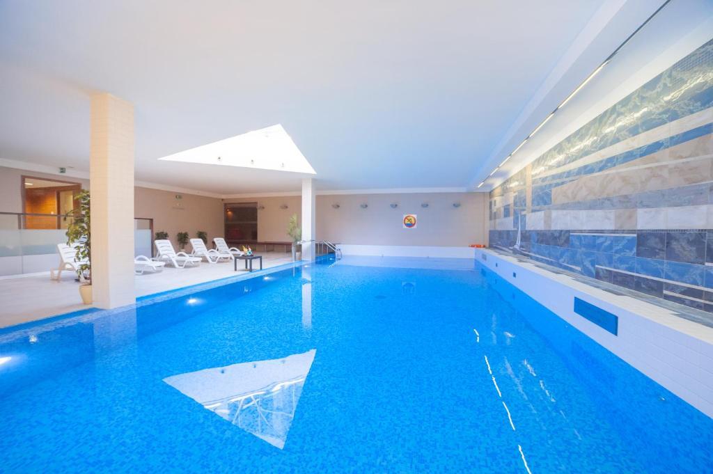 The swimming pool at or near Best Western Premier Kraków Hotel