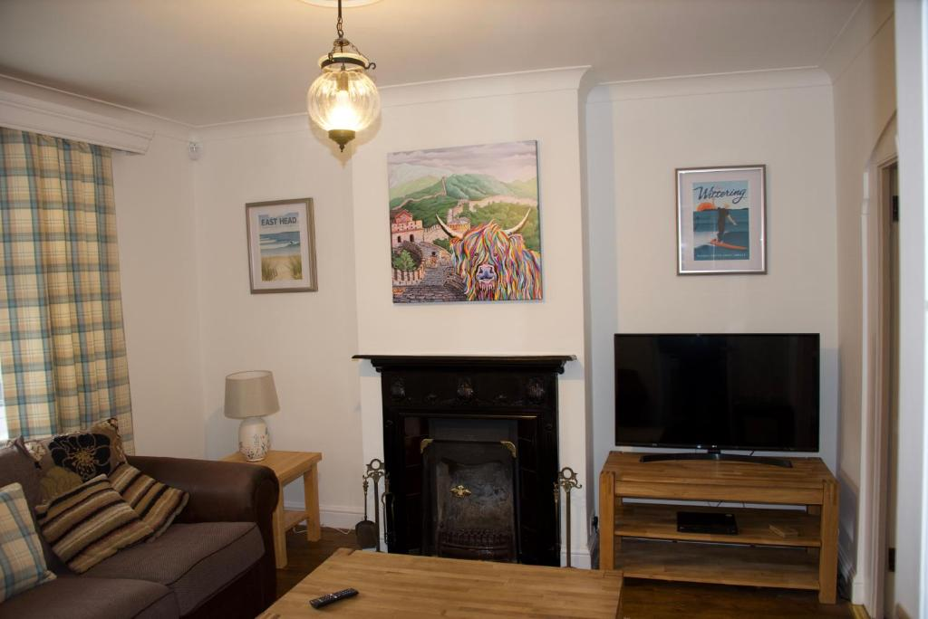 A television and/or entertainment center at Fontwell Cottage