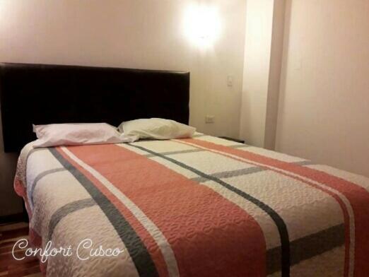 Cama o camas de una habitación en comfort cuzco