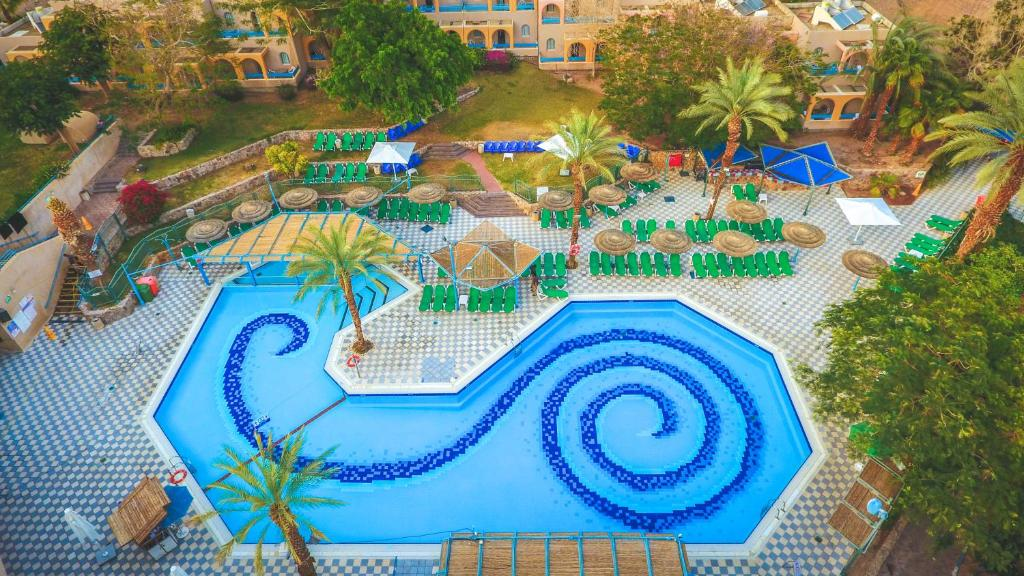 A view of the pool at Club In Eilat - Coral Beach Villa Resort or nearby