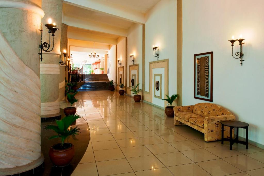 The lobby or reception area at Neptune Beach Resort - All Inclusive