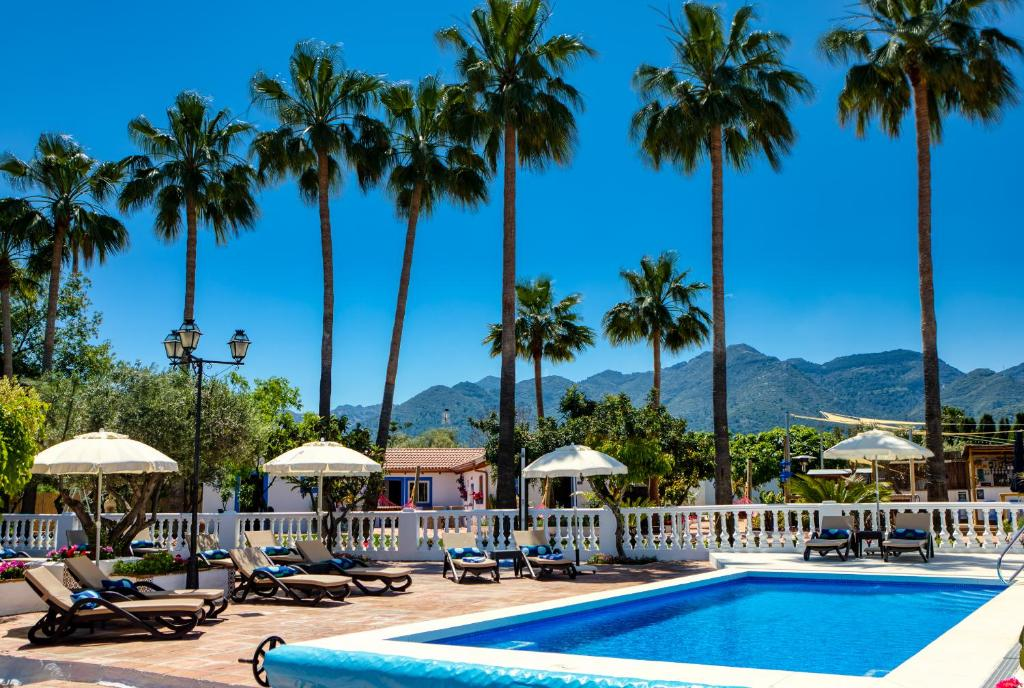 The swimming pool at or near The Palms Boutique Resort Málaga - Adults Only