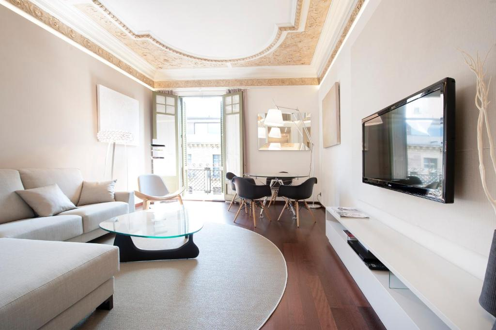 Ein Sitzbereich in der Unterkunft You Stylish El Borne Apartments