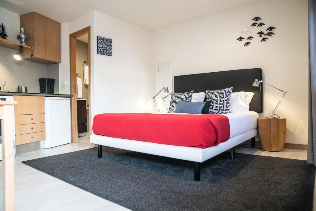 A bed or beds in a room at Islands of Porto by Apartments2Enjoy