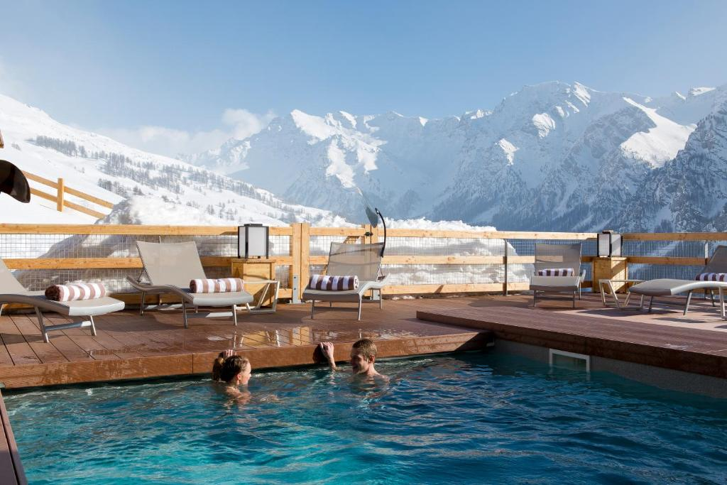 The swimming pool at or near Hôtel & Spa L'Alta Peyra