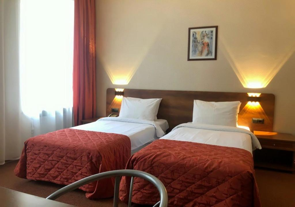 Cama o camas de una habitación en Columb Hotel