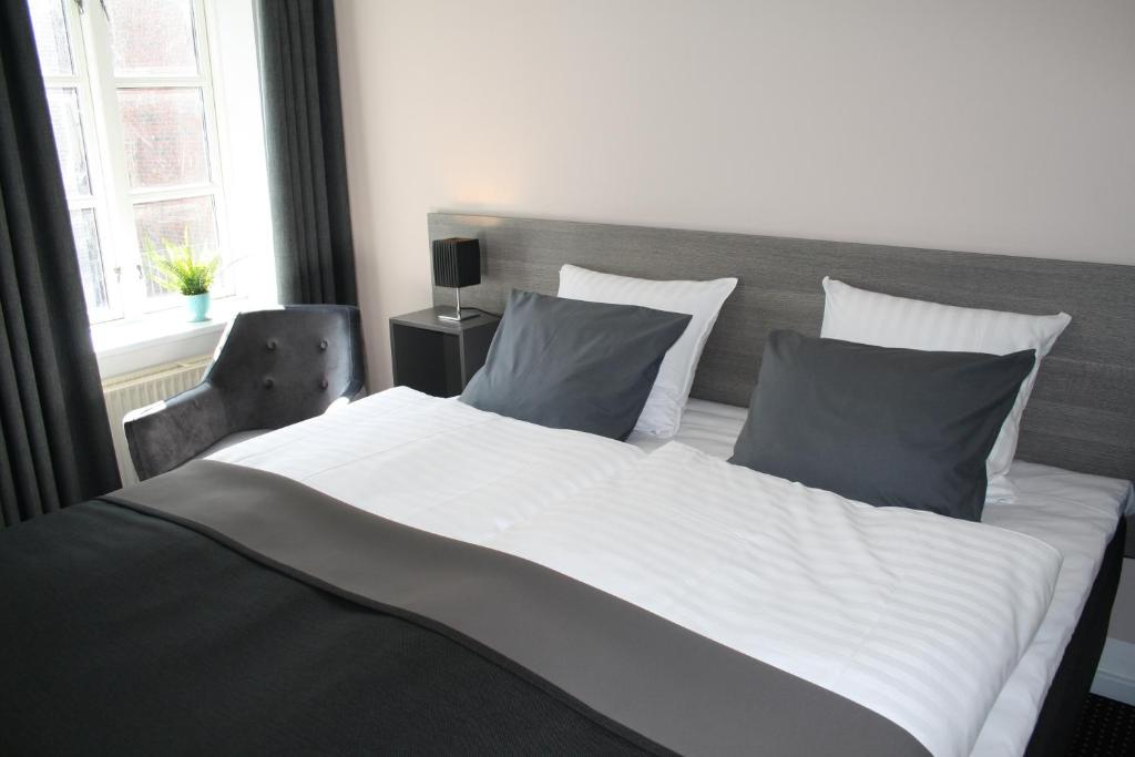 A bed or beds in a room at Hotel Aarhus City Apartments