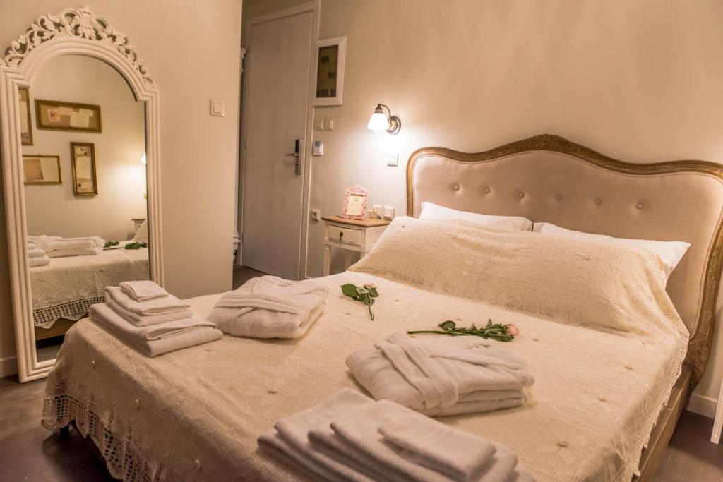 A bed or beds in a room at Kyria Boutique House