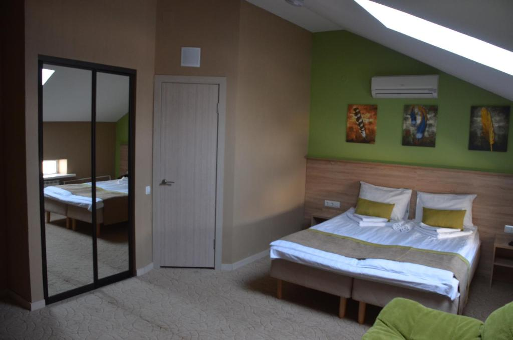 A bed or beds in a room at Letuchaya Mysh Hotel