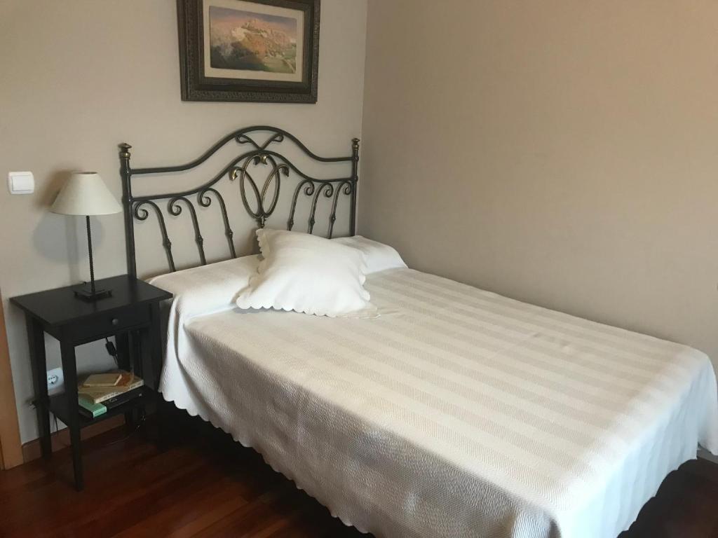 A bed or beds in a room at Habitación independiente con baño privado