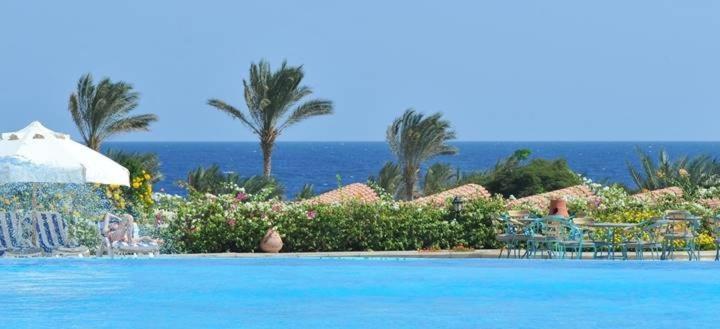 The swimming pool at or near Royal Brayka Beach Resort