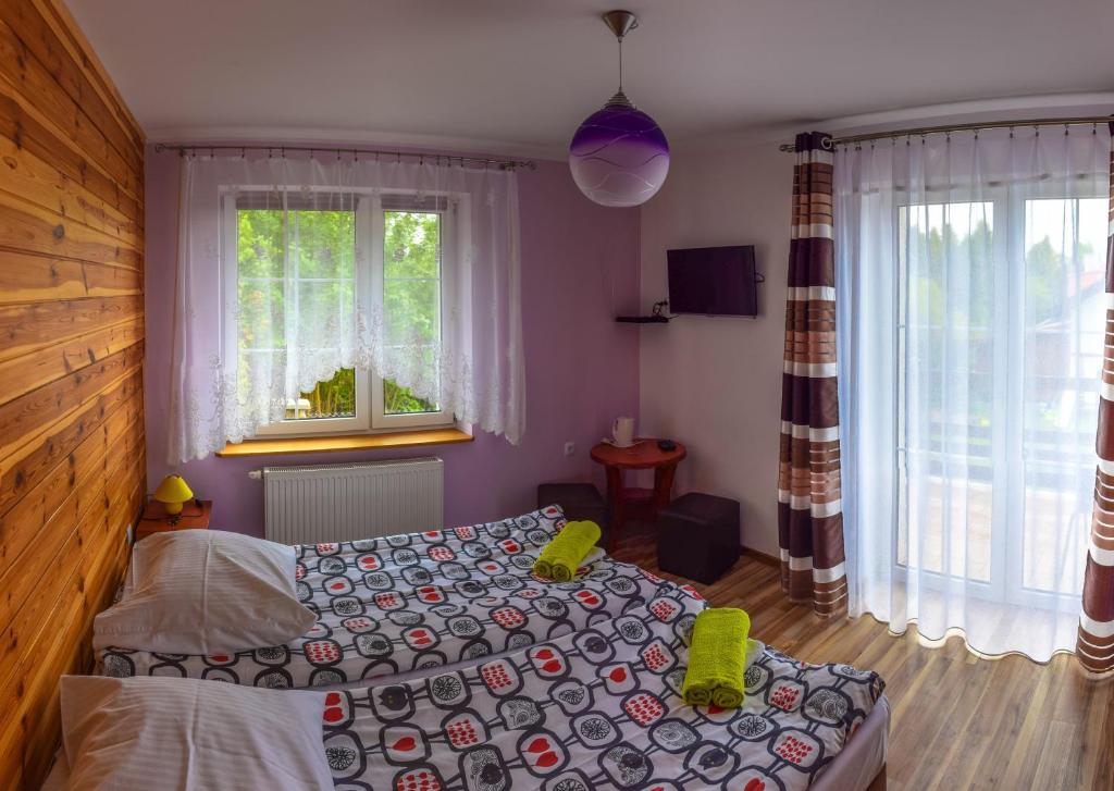 Кровать или кровати в номере Villa Varmia