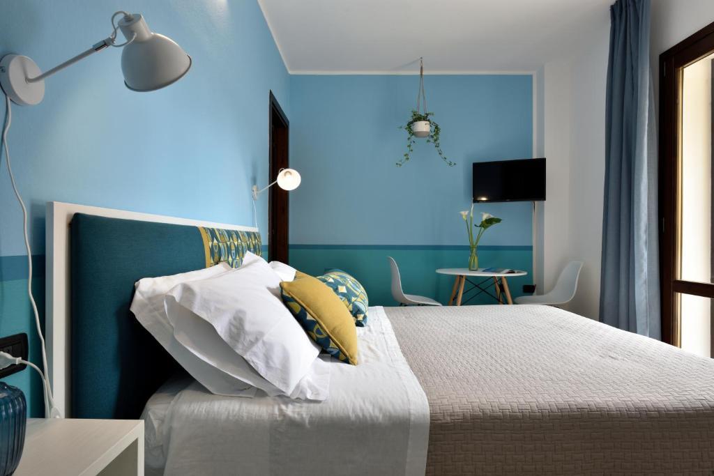 Letto o letti in una camera di La Tortorella Room & Apartment
