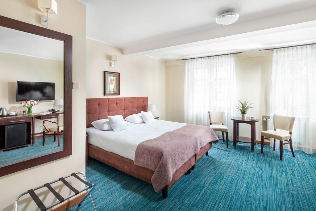 Lova arba lovos apgyvendinimo įstaigoje Hotel Bonum