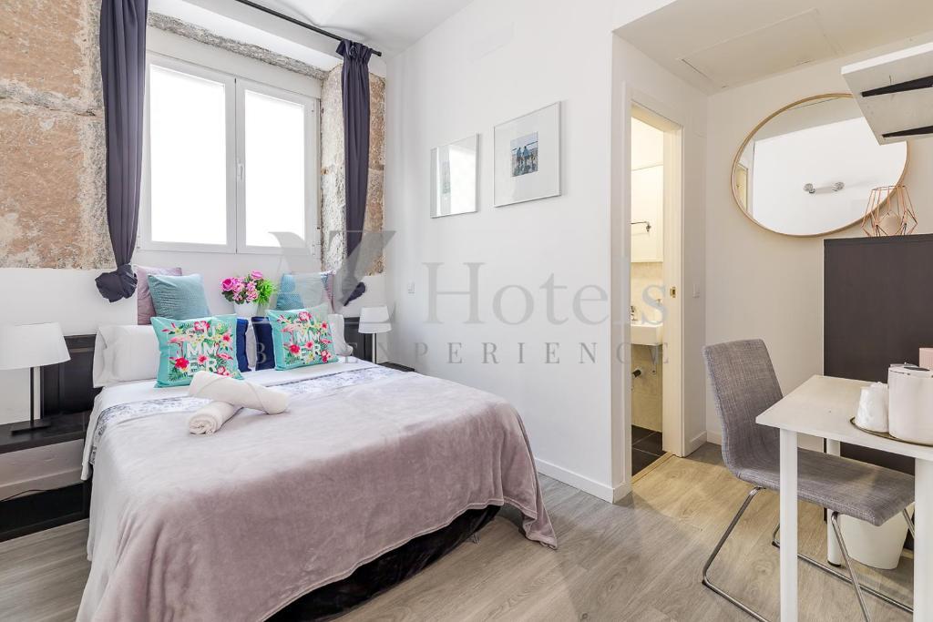 A bed or beds in a room at A&Z JUAN DE MENA