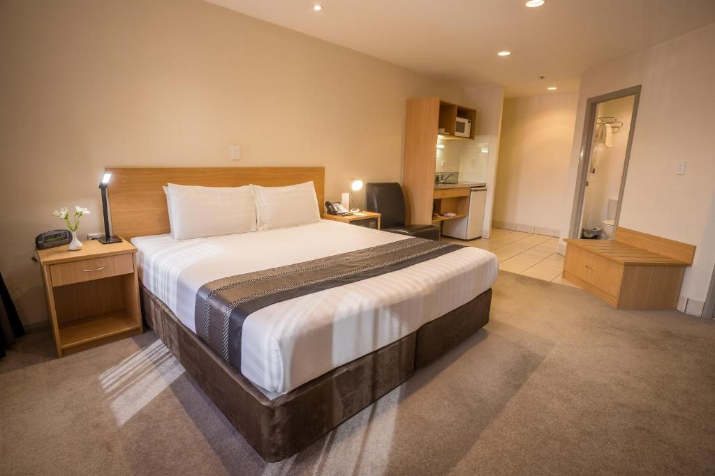 A bed or beds in a room at President Hotel Auckland