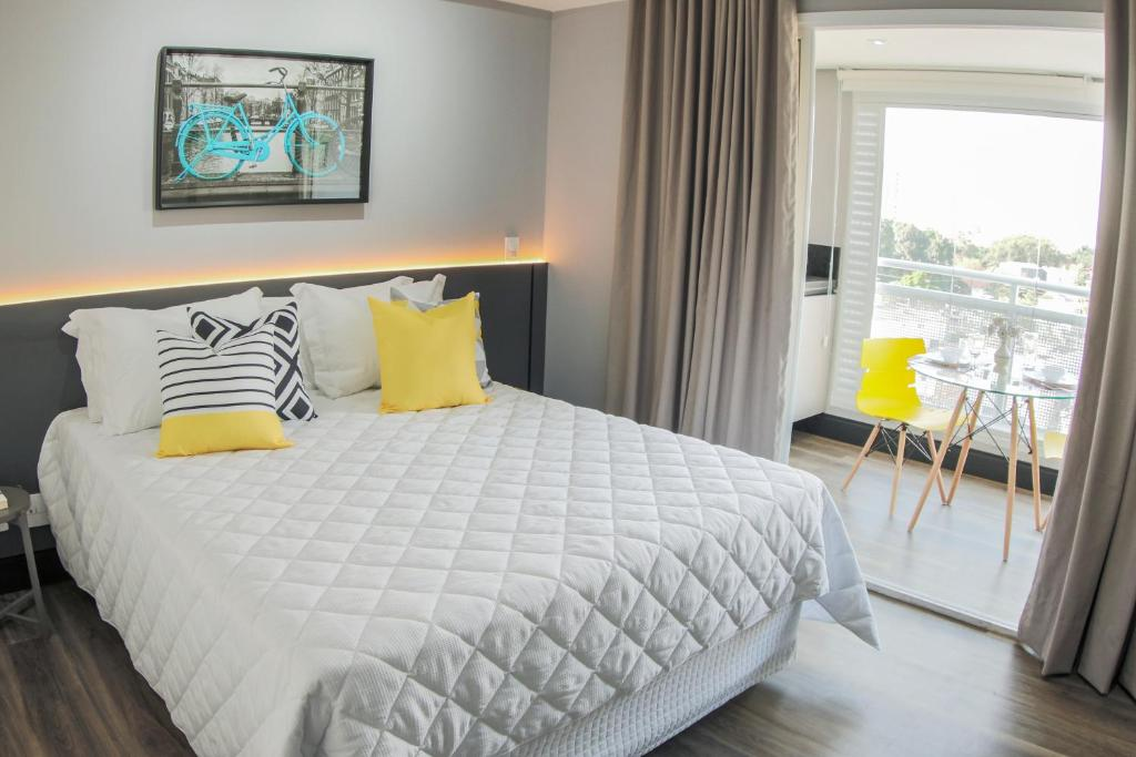 Cama ou camas em um quarto em Ispecialle Studios Congonhas