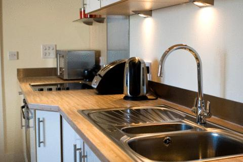 A kitchen or kitchenette at BayView Apartments Pool and Spa Resort