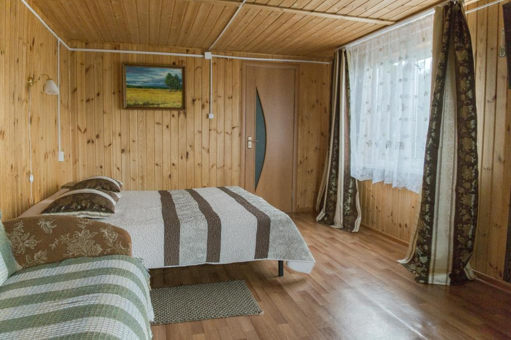 A bed or beds in a room at Guest House Baikal Yeti