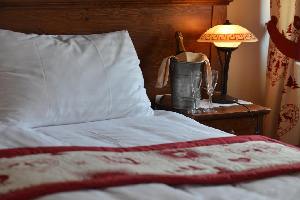 Un ou plusieurs lits dans un hébergement de l'établissement Hôtel de Gruyères