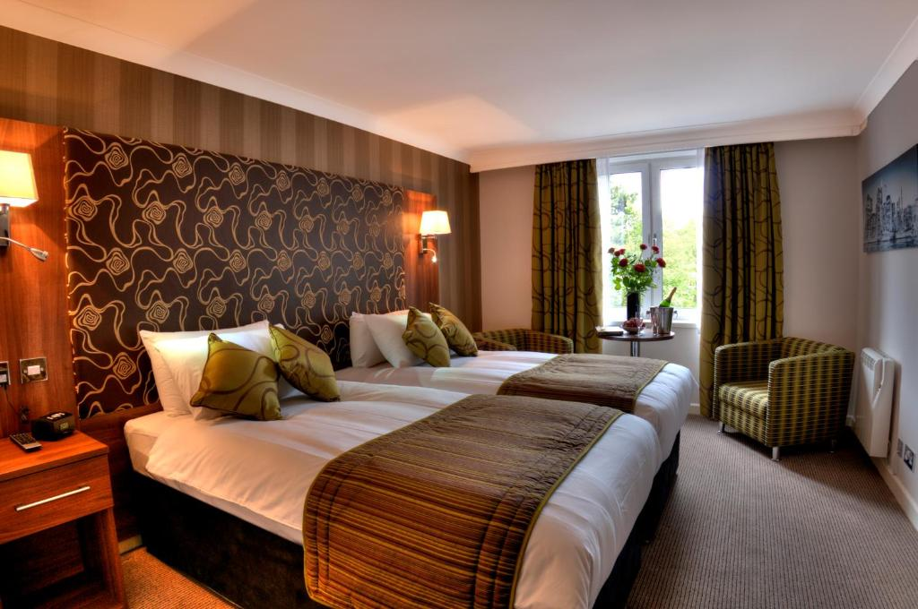 A bed or beds in a room at The Collection Hotel Birmingham
