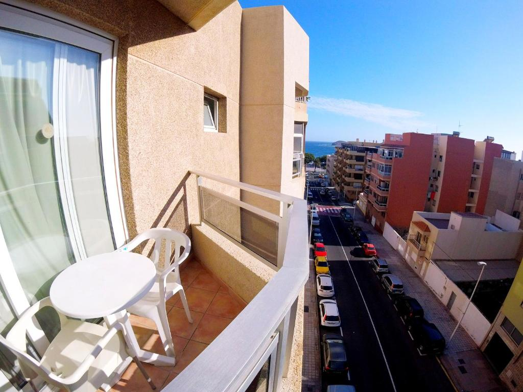 Een balkon of terras bij Hostal Carel