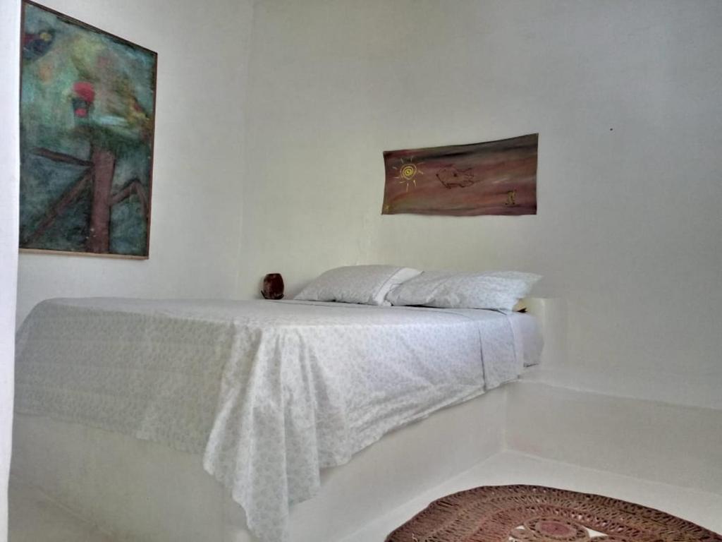 Cama ou camas em um quarto em Ateliê do Kite