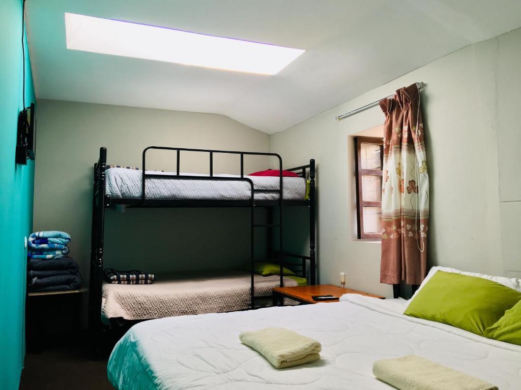 Litera o literas de una habitación en Three Leaves B&B Cusco