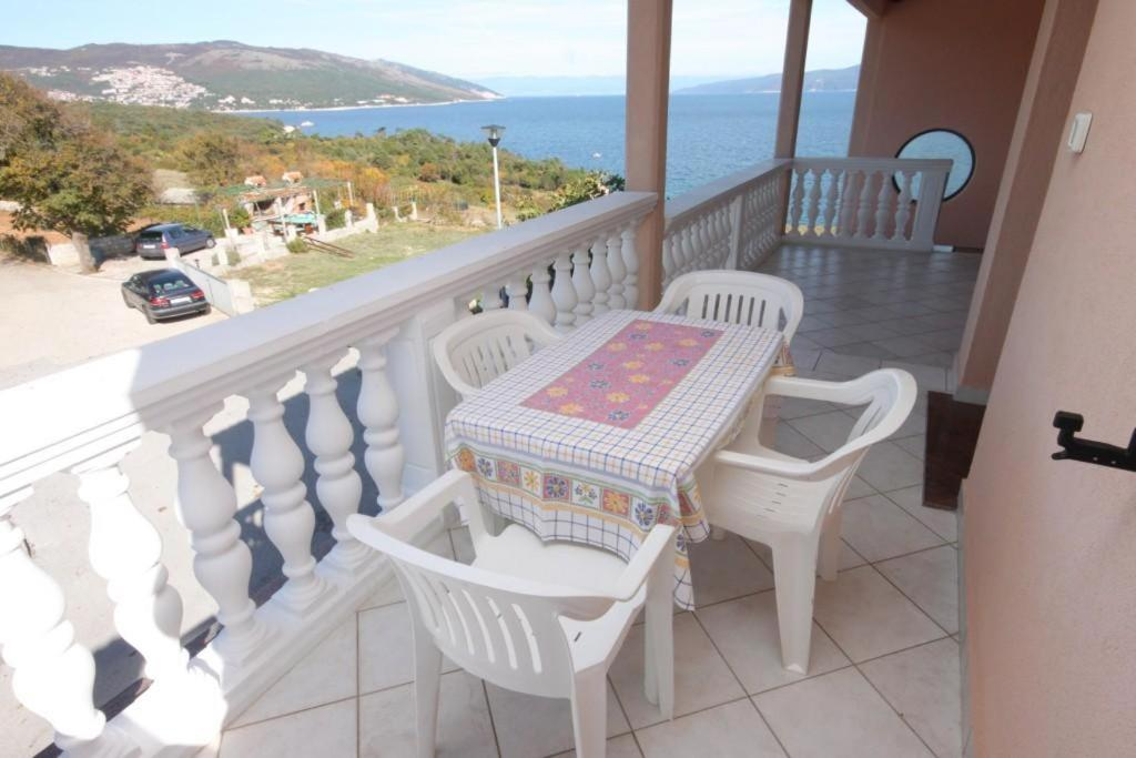 A balcony or terrace at Apartments by the sea Duga Luka (Prtlog) (Labin) - 2367