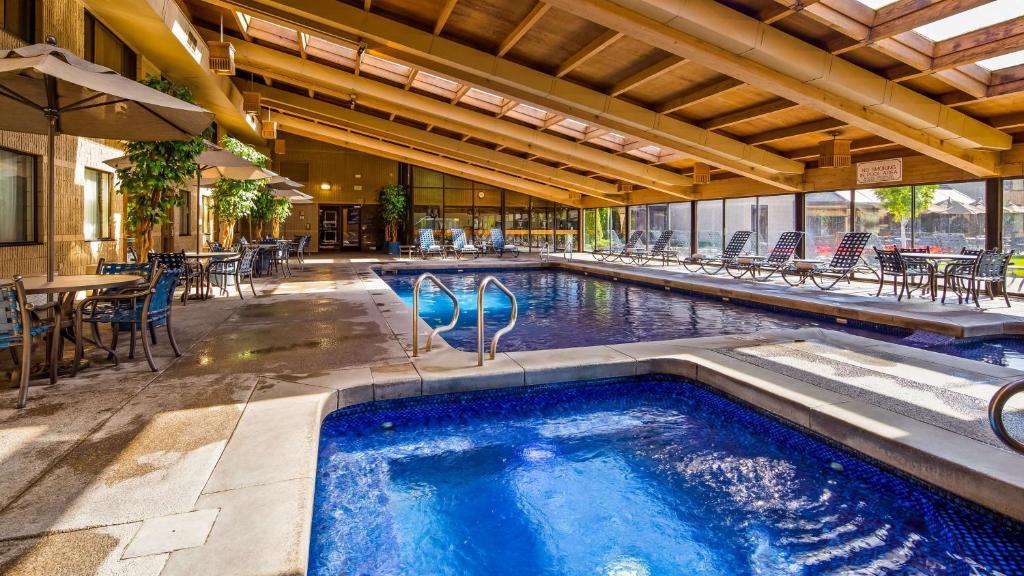 The swimming pool at or near Best Western Plus University Inn