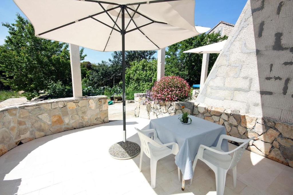 A patio or other outdoor area at Apartments by the sea Pomena (Mljet) - 10426