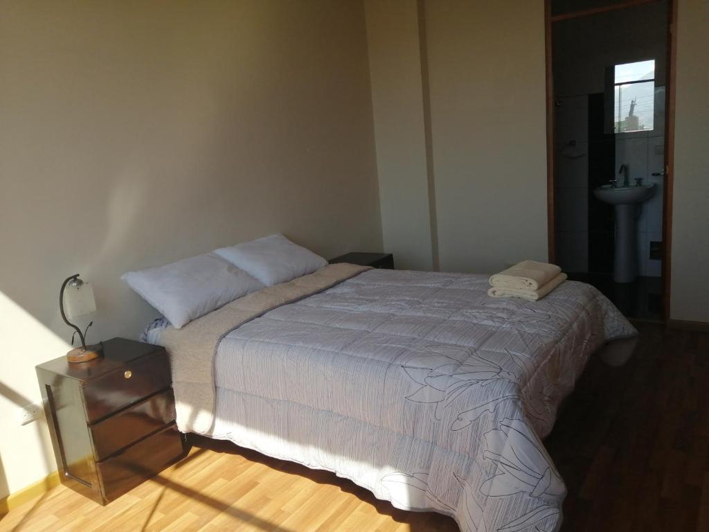 Cama o camas de una habitación en Joluva Hospedaje