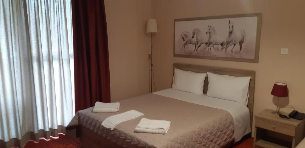 A bed or beds in a room at Vasilis