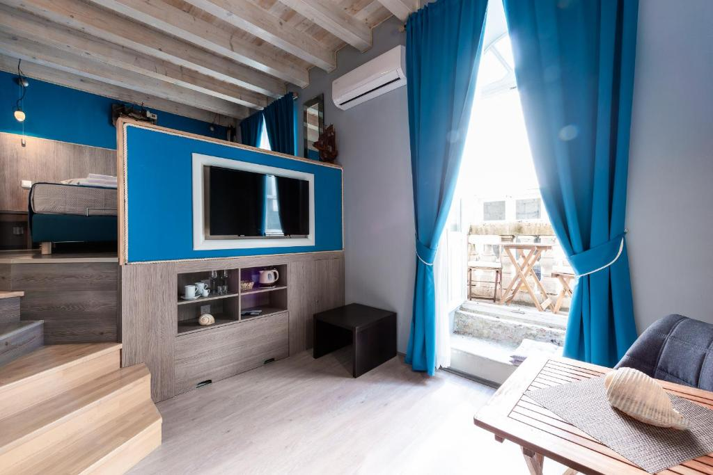 A television and/or entertainment center at Nautica Rooms