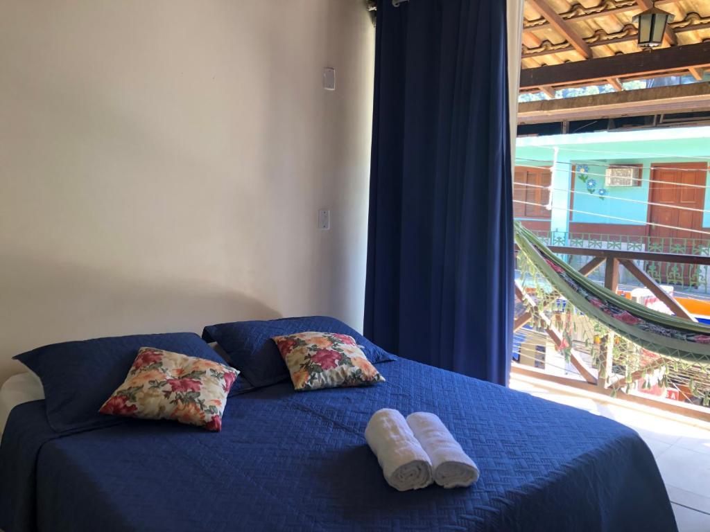 Cama ou camas em um quarto em Pousada Porto do Sol