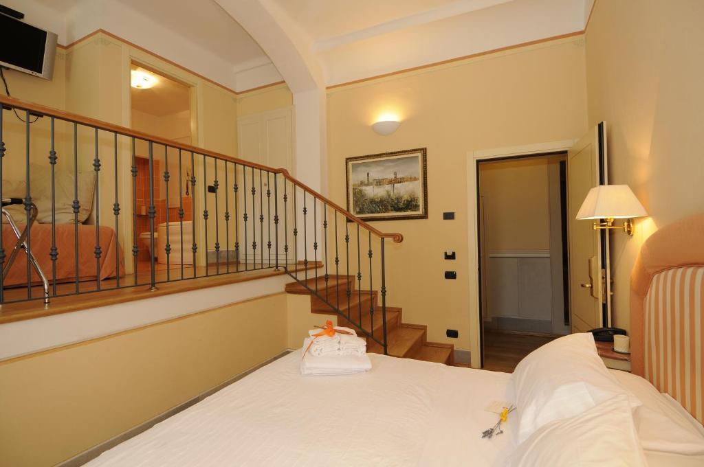 Letto o letti in una camera di A Palazzo Busdraghi Residenza D'Epoca