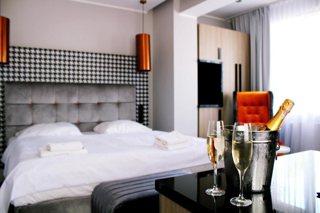 Łóżko lub łóżka w pokoju w obiekcie Hotel Bursztyn