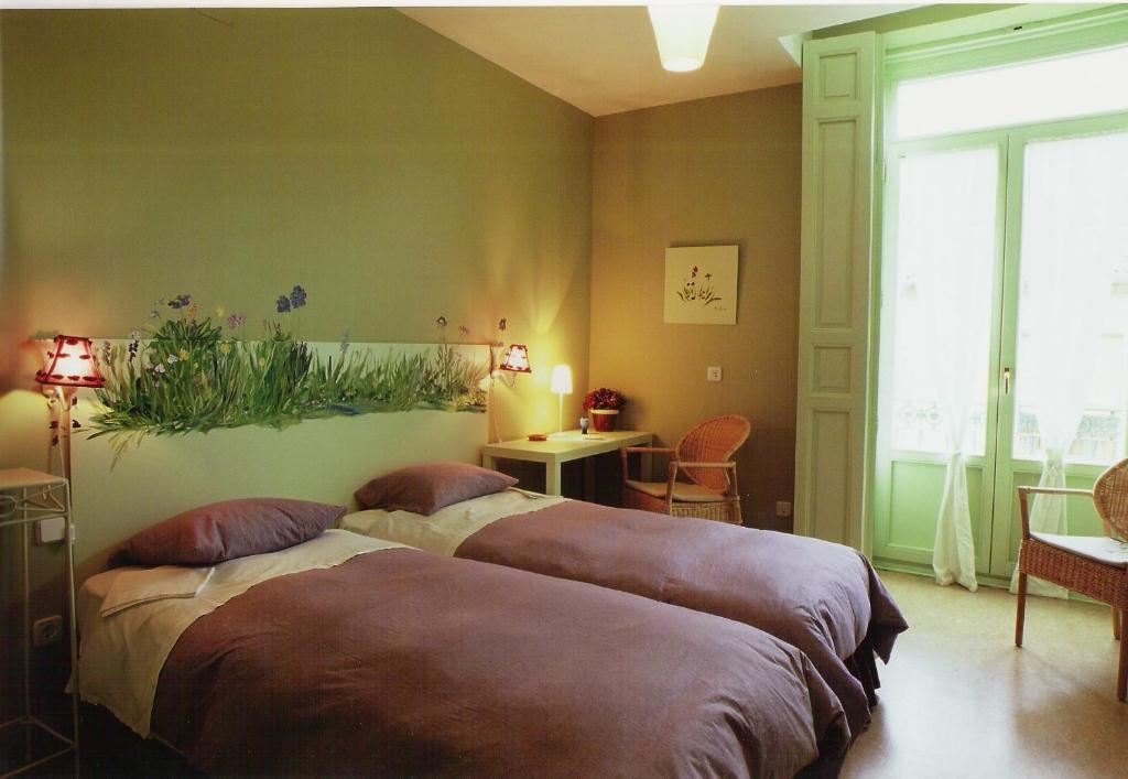 Cama o camas de una habitación en Hostal Fornos