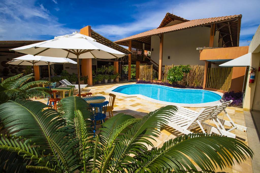 The swimming pool at or close to Vivá Barra Hotel Pousada